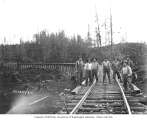 Asian construction crew standing on railroad trestle, Schafer Brothers Logging Company, n.d.