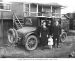 John Schafer [1893-1956] with wife Neta Smith Schafer and daughter Bernice beside 1922 Buick Six...