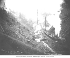 Yarding operation in a ravine, with Heisler locomotive and log train being loaded, Walville Lumber...