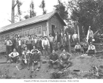 Logging crew with saws outside saw filers workshop, Walville Lumber Company, ca. 1919