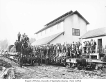 Logging crew on railroad flatcars at locomotive shed, West Fork Timber Company, n.d.