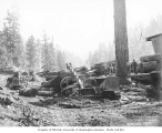 Logging crew at yarding operation using a Caterpillar tractor and log yoke, West Fork Logging...