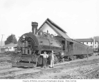 West Fork Timber Company's 75-ton Baldwin saddle tank locomotive no. #75 with two crew transport...