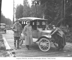 Spruce Division soldiers and Model T Ford with puppy on hood, ca. 1918