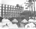 Spruce Division camp 7R and railroad trestle under construction beside ocean beach, ca. 1918
