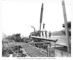 Crew at railroad loading spur with boom loading logs, Raymond, ca. 1918