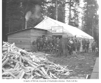Spruce Division soldiers outside large tents with sign reading Knights of Columbus Headquarters,...