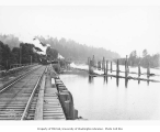 Baldwin Mallet locomotive with log train on a side track at a log dump, Clemons Logging Company,...