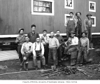 Asian crew and child at railroad camp, n.d.