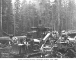 Logging crew with CAT tractors and diesel donkey engine in background, Schafer Brothers Logging...