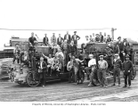 Lumber mill crew, including Asian workers, with two Ross lumber carriers, Schafer Brothers Lumber...