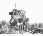 Crew and steam donkey on flatbed railroad car on tracks, camp A, Snoqualmie Falls Lumber Company,...