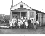 Children in front of school house, camp no. 5, Simpson Logging Company, ca. 1940