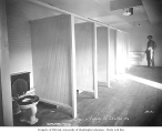 Interior of bathroom at railroad logging camp, Simpson Logging Company, n.d.
