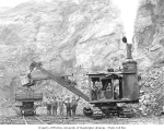 Crew with steam shovel loading motorized dump car with rocks, Weyerhaeuser Timber Company,...