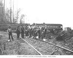 Track gang with Weyerhaeuser Timber Company coaches in the background, n.d.