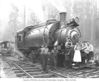 Crew and waitresses with Wynooche Timber Company's two-truck Baldwin saddle-tank 2-6-2T locomotive...