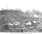 Wynooche Timber Company's camp no. 2, showing water tower, bunkhouses, saw filer shack and trestle...