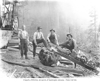 Logging crew with gasoline-powered dragsaw beside donkey engine, Wynooche Timber Company camp no....