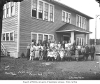 Children and teachers in front of the Carlisle Public School, ca. 1917