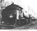 Crew with Weyerhaeuser Timber Company's 2-6-6-2 split-saddle tank Baldwin locomotive no. 110 and...