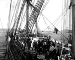 Crew on deck of the Northwestern Fisheries Co. cannery ship ST. PAUL leaving Seattle, Washington,...