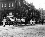 Golden Potlatch Parade, Seattle, float with totem poles.