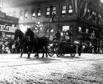 Golden Potlatch Parade, Seattle, showing 1876 fire engine (hose cart with hand pump).