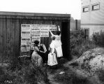 Posting signs to promote woman suffrage, Washington Equal Suffrage Association, Seattle, 1910.