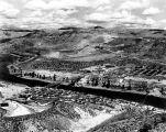 Columbia River below Grand Coulee Dam, showing Mason City and, in foreground, engineers' camp.
