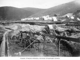 Men shoveling dirt into sluice at 4 Eldorado, Eldorado Creek, Yukon Territory, ca. 1898