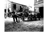 Horse-drawn hose cart and fire fighters in front of Madison St. Firehouse #5, Seattle.