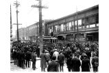 Crowd surrounding streetcar during strike against Seattle Electric Co., in front of Bon Marche,...