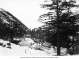 Buildings and tents on wagon road, White Pass Trail, ca. 1898
