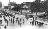 Brass band marching down 2nd Ave. near Cherry St., looking north, Seattle, 1886