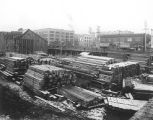Construction of Great Northern Railroad tunnel beneath downtown Seattle showing the material yard...