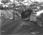Electric locomotives of the Great Northern Railroad exiting Cascade Tunnel, Stevens Pass, Cascade...