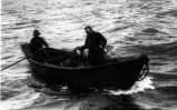 Halibut fishermen setting the line from a dory on the Pacific halibut banks off the Alaska coast.