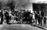 Seattle Volunteer Fire Co. engine Number 1 in 1883 at Seattle engine house on Columbia St.