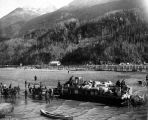 Landing supplies by lighter on the beach at Skagway, Alaska, 1897.