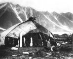 "Eskimo igloo, Plover Bay, ""built of sod and whale bone and roofed with walrus skins."""