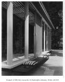 Richards residence exterior showing bench, Bellevue, 1958