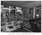 Miller residence interior showing living room and deck, Mercer Island, 1956