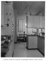 Miller residence interior showing kitchen and breakfast nook, Mercer Island, 1956