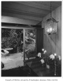 Miller residence interior showing dining area and patio, Mercer Island, 1956