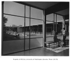 Chinook Junior High interior showing windows to courtyard, Seattle, 1958