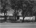 Medford Clinic exterior showing side of building and side entrance, Oregon, 1959