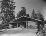 James Walsh House exterior showing garage and carport, Seattle, 1953