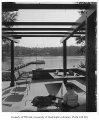 McRae residence exterior showing patio and dock, Bellevue, 1958