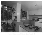 Burnett residence interior showing dining area and kitchen, Seattle, 1952